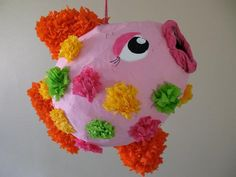 Tropical Fish Pinata I LOVE THIS IDEA!!    When your kids are finished making this pretty little fish, they may not have the heart to demolish their handiwork! Never fear. Just pour the candy and treats from her mouth.    •View the full Tropical Fish Pinata instructions  Basic Materials: Balloon, newspaper, flour, paint, crepe paper, sponge
