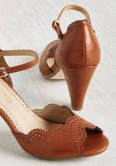 Taking on a challenging lecture plan in these brown peep toes by Restricted shows you're set to excel at this student teaching sesh. Tapered heels support the scalloped 'n' perforated motif of these faux-leather kicks, which have more than 'learned' their keep to be part of your profesh wardrobe!