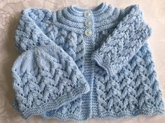 Hand Knitted Baby Boys Blue Matinee Cardigan and Hat. £10.49