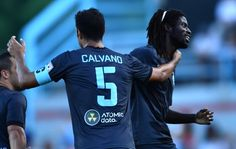 Minnesota United FC defender Tiago Calvano (5) celebrated with forward Ismaila Jome (15)