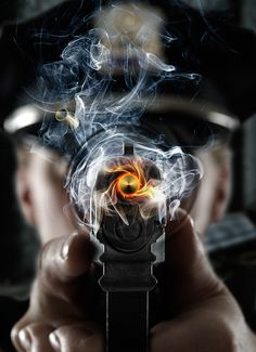 Amazing photography of a bullet firing out of the bore of a gun!