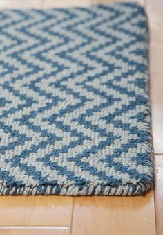This soft and springy loom hooked rug will bring casual comfort to any room. This rug is hand woven of recycled eco cotton, using no latex, chemicals or dye