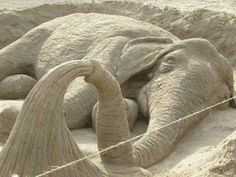 Sand art is the practice of modelling sand into an artistic form, such as a sand sculpture, sandpainting, or sand bottles. A sand castle is . Elephant Love, Elephant Art, Elephant Stuff, Happy Elephant, Elephant Sculpture, Elephant Trunk, Snow Sculptures, Sculpture Art, Ice Art