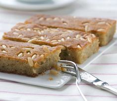 Greek desserts Samali recipe (Extra syrupy Greek Semolina cake with Mastic) Greek Sweets, Greek Desserts, Arabic Sweets, Arabic Food, Baklava Dessert, Halva Recipe, Greek Cake, Greek Pastries, Cake Recipes