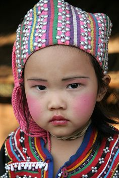 ˚A little Lahu girl in a village of northern Thailand...