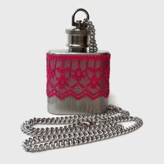1oz stainless steel hip flask necklace dark reddish pink lace    The 1oz measures 2 3/4 x 1 5/8 (70 x 41 mm)    Chain length is 24 inches. Actual
