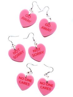Cheeky heart dangle earrings made of silver hardware. Charm measures 1.5inches. Handmade in NYC.