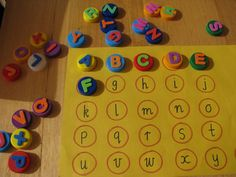 Alphabet Match with bottle tops as well as many other bottle top ideas