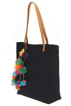 "This is a MUST have Tote bag for this spring & summer season. It features a linen material, colorful threaded pom pom & tassel details, one inside compartment, 2 small pouches and a zippered pocket with a top magnetic closure. You can use this as a handbag or as your beach or pool bag.  H:14"" L:15"" W:3"" MATERIAL: Linen 1 Inside Compartment and 1 Zippered Pocket 2 Small Pouches Magnetic Closure Interior capacity: large ALL CLEARANCE SALES ARE FINAL!"