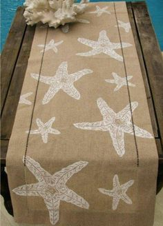 Natural Linen Table Runner with White Starfish   I saw turquois burlap that would with my theme but not sure I will be doing it, but I sure like it.