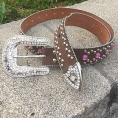 """‼️ HOUR SALE‼️Pink Bling Belt Pink Bling Belt. 47"""" long 1 1/2"""" wide. Size of belt is a large. Has snaps on belt so you can change buckle. Has pink gems and silver rivets. Silver beads outlining the belt. Worn a few times but in excellent condition. Name brand is Blazin Roxx . Missing 3 stones at end of belt Blazin Roxx Accessories Belts"""