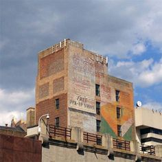 Free Pick-Up Service ghost sign in Jersey City