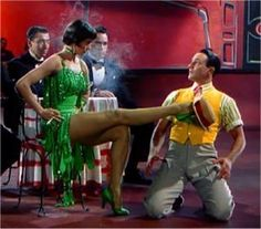 Gene Kelly Cyd Charisse: Singing in the Rain...Checkout the video on this site of the number