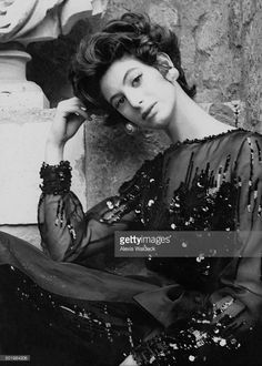 Donna Allegra Caracciolo di Castagneto wearing jet-and-bronze-spangled black organza jumpsuit by Federico Forquet; earrings by Mimi di N; coiffure by Sergio of Eve of Roma; in the Villa Savoia garden, Rome.