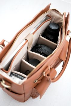 Looking for a Camera Purse? Avana is a functional Camera Bag that is also great as a Laptop Bag, Work Bag and Diaper Bag. Looking for a Camera Purse? Avana is a functional Camera Bag that is also great as a Laptop Bag, Work Bag and Diaper Bag. Nikon D5200, Dslr Nikon, Leica Camera, Camera Purse, Leather Camera Bag, Leather Bags, Dslr Photography Tips, Photography Equipment, Photography Projects