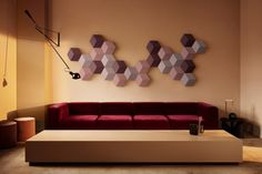 BeoSound Shape, the new offering from Bang & Olufsen, hides speakers in plain sight. BeoSound Shape is a wall-mounted, modular speaker system based on hexagonal tiles. These can be placed creatively on the wall in every