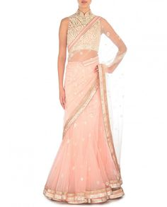 This pink colour lehenga saree is made in net fabric with with embellished border. This lehenga saree is teamed with a net blouse with intricate embroidery and matching petticoat. This product is ship