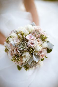 This is a very pretty understated bouquet. I wonder how It would look in a vase?