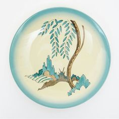 'blue mowcop' a clarice cliff plate | Woolley and Wallis