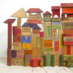 miraremh: via etsy.com CometWreckage's shop > Glass / Brass / Sass >collection of vintage wooden building blocks