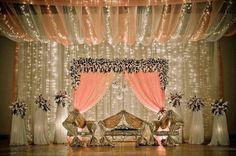 Lovely peach and gold wedding stage with flowers, lights Wedding Stage Design, Wedding Stage Decorations, Wedding Themes, Wedding Designs, Wedding Ideas, Desi Wedding Decor, Church Decorations, Wedding Mandap, Wedding Venues