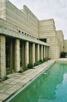 Ennis House, Frank Lloyd Wright - architectural landmark.  Near the top of Vermont Avenue sits the Ennis House done by Frank Lloyd Wright in 1924, which dominates its surroundings as a modular masonry structure composed of square concrete bricks. Its inspiration is rather obvious, as Wright's love for Mayan art and architecture connects this residence to the culture's highly ornamented, symmetric and organized structures.  It was originally built for Mabel and Charles Ennis in 1924.