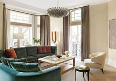 Luxurious finishes and jewel tones turn a Victorian-era pied-à-terre into a showstopper. #londonapartment #piedaterre #luxury #home #hometour #apartmentinspo #interiordesign #apartmenttour #interiors #victorianhome #design #elledecor Living Room, Interior, American Interior, Apartment Living Room, London Apartment, Apartment, House Interior, Elle Decor, Interior Design