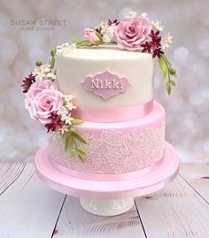 Vintage style two tier birthday cake with dusky pink flowers and Ivory lace