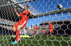Stephan Lichtsteiner and players of Switzerland react after conceding...