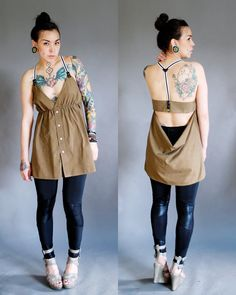 Love the sewing pin holder on her hand and I'm pretty sure her whole stomach is inked. She also has dots on her face, which is a little extreme.
