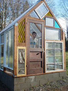 salvaged window greenhouse - - plans old windows Greenhouse Farming, Window Greenhouse, Small Greenhouse, Greenhouse Plans, Greenhouse Wedding, Backyard Greenhouse, Portable Greenhouse, Homemade Greenhouse, Greenhouse Kitchen
