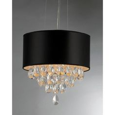 Add some elegance to your home with this crystal chandelier. This dynamic lighting element features generous rows of cascading crystals to catch the light along with a bold black shade.