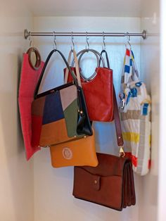 """If you're not sure what to do with those tiny nooks around your house or apartment, then we have a solution to ensure they get used to their full potential. By using a tension rod from an old window treatment and some simple shower curtain rings, you can turn those once """"dead"""" spaces into prime real estate for storing handbags, kitchen utensils, accessories and more. Photo courtesy of Brit Morin"""