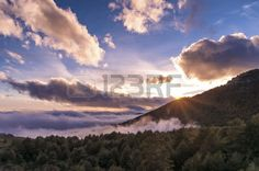 Beautiful sunset with low clouds and the Smoky Mountains in the natural park of Guadarrama in Madrid, Spain