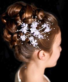 A long brown straight wedding bridal plaited updo child hairstyle by Annette Bradford