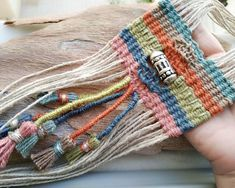 Stunning woven tribal necklace, nomad style, with large sterling silver engraved bead on colorful jute and hemp cord. Colors: ocean and sky blue, rusty red, dusty pink, olive green. The large woven pendant ends up in long hemp fringes and handmade colorful tassels. Woven part length: