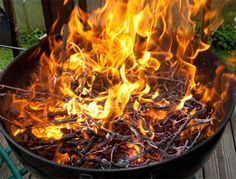 Grilling with wood produces unmatched flavor and aroma, but it is tricky. Here's how to do it.