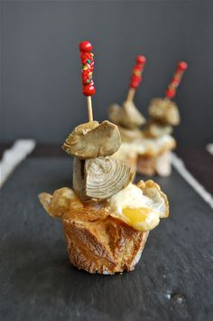 artichokes preserved in extra virgin olive oil, goose or duck foie, a fried quail's egg and salt.