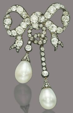 AN ANTIQUE NATURAL PEARL AND DIAMOND BROOCH. Designed as a ribbon bow, set with old-cut diamonds and suspending two detachable drop-shaped pearls, weighing approximately 96 and 92 grains, mounted in silver and gold, circa 1870, 9.0 cm, in red leather fitted Garrard & Co. case.