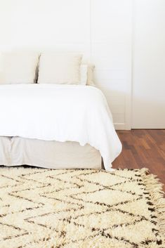 Warm up your bedroom with a classic Moroccan rug - 'Baker St' Beni Ourain in ivory and brown available from https://tigmitrading.com/collections/beni-ourain-rugs/products/baker-street-beni-ourain