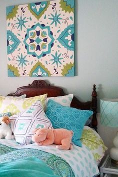 Refreshing your guest bedroom can be as easy as adding a new over-sized piece of art!