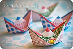 This is just so cute! and so easy to make! Instructions are on Mardi Gras Outlet website. Paper Boats as place cards or candy holders