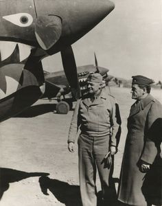 Gen. Henry 'Hap' Arnold looks at a Curtiss P-40 with Gen. Claire Chennault (right). Since 1937 Chennault had advised and trained Chinese pilots and after 1941 lead the 'Flying Tigers.' February 1943.