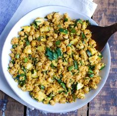 Zucchini Chickpea Quinoa Salad mixes zucchini, chickpeas, quinoa, fresh parsley and green onions and is tossed in a spiced olive oil dressing. This salad has the rich, warm flavors of cumin, turmeric and paprika and makes a healthy, filling lunch.