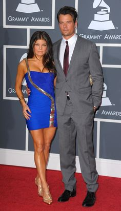Fergie and husband Josh Duhamel bring some fashionable boom boom pow to the red carpet at the 52nd GRAMMY Awards in 2010