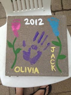 grandma's garden stone with footprint flowers from the babes!