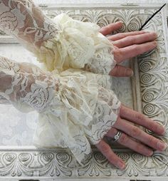 ANGEL vintage Victorian steampunk lace cuffs, fingerless lace gloves in ivory lace, free gift boxing. $15.00, via Etsy.