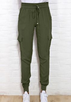 This pair of rifle green cargo joggers is non-stretchable, has a mid-rise waist with drawstrings, and leg pockets. Shop this style. | Lookbook Store Pants and Leggings