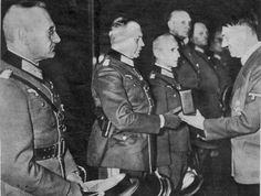 Upon the conclusion of the conquest of Poland, a smiling Adolf Hitler decorates his generals with the Knight's Cross of the Iron Cross, Nazi Germany's highest decoration for valor. From left to right: Halder, Guderian, Hoth, Strauss, Hoepner, Olbricht. Those were heady days -- before Hitler became obsessed with beliefs that his generals disobeyed his orders and avoided pursuing the war with the requisite determination.