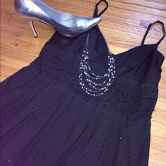 Stunning Little Black Dress with beading detail Stunning Little Black Dress with beading detail throughout. Has adjustable Spaghetti strap top with satin lined cups. Can be worn on date night, or any other formal event. Is approximately a size 6. In excellent condition. No rips stains or flaws. Dresses